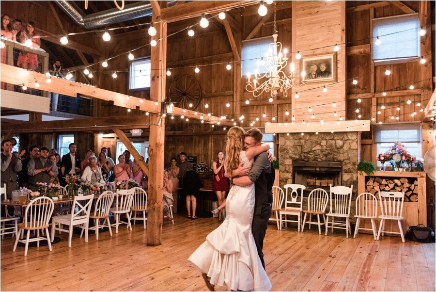 Bride and groom inside the barn under a chandelier