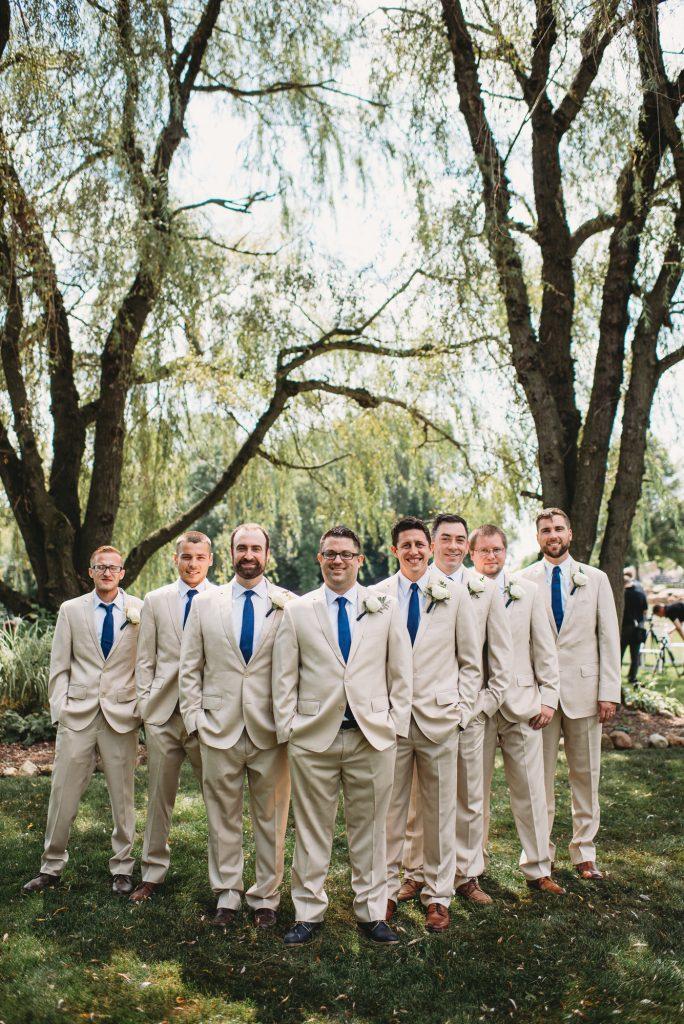 Groom and groomsmen outside under trees